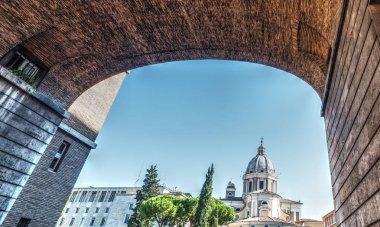Santi Ambrogio and Carlo dome seen through an arch
