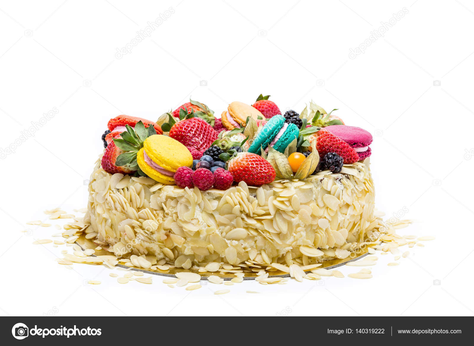 Almond Cake Topped With Assortment Of Macarons Stock Photo