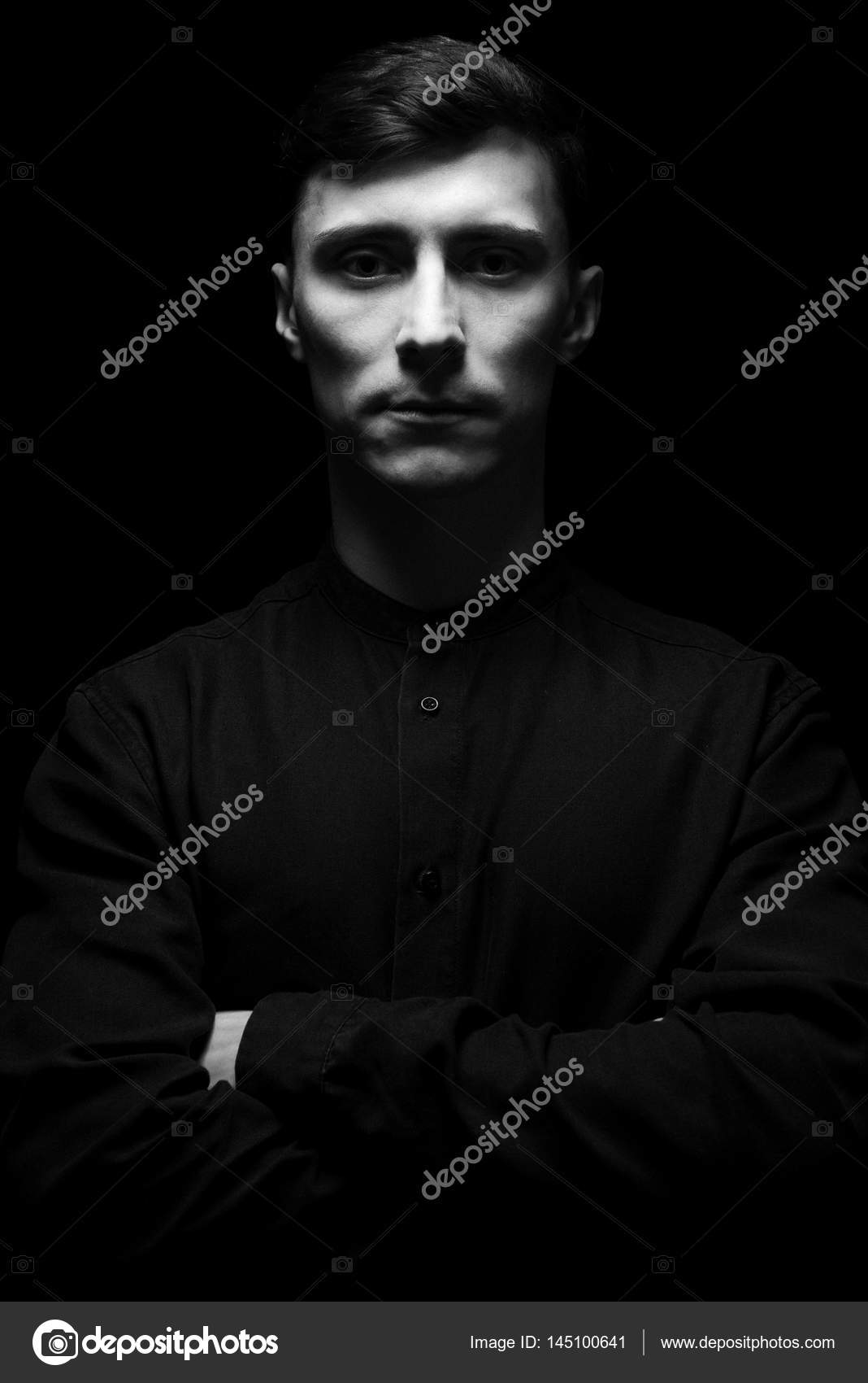 Low key portrait of a man in black shirt in black and white photo by pogrig001gmail com