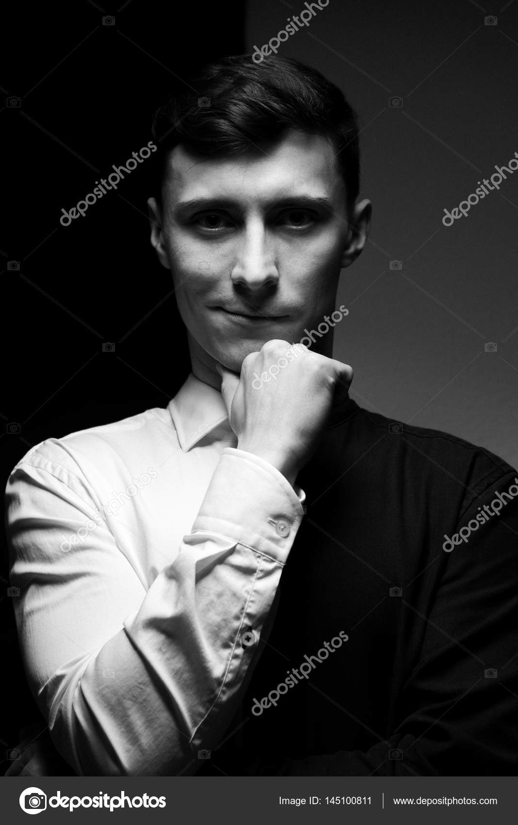 Low key portrait of a man in different shirts in black and white photo by pogrig001gmail com