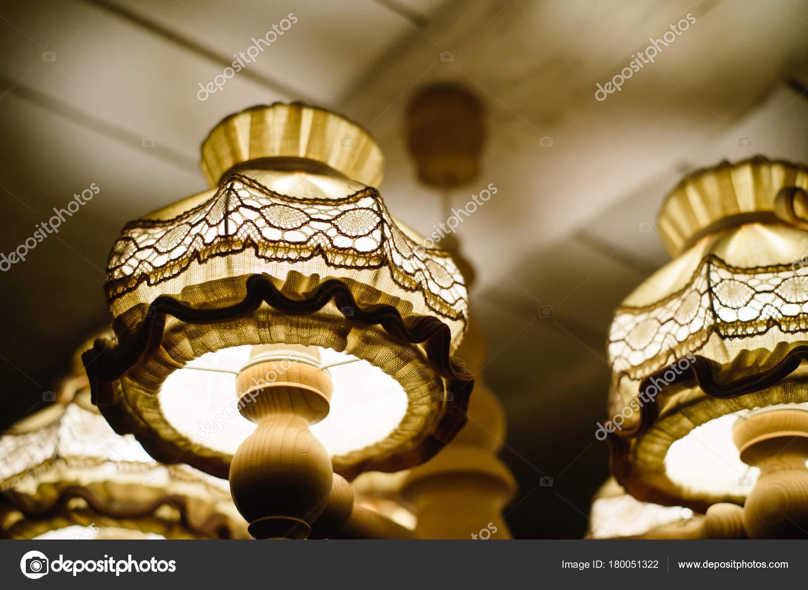 Closeup view of contemporary light fixture in dark room stock