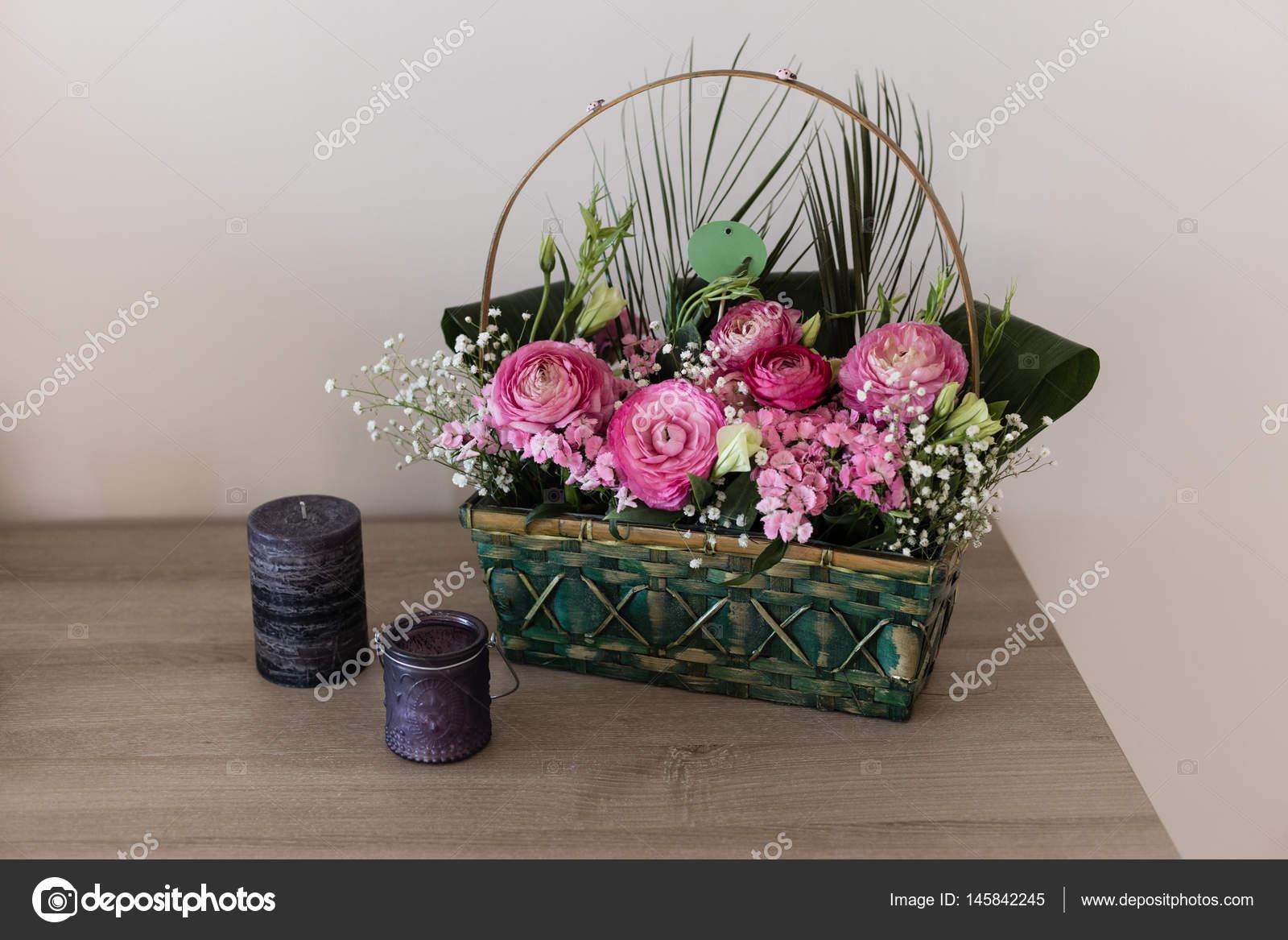 Flower arrangement in basket with ranunculus and small pink and flower arrangement in basket with ranunculus and small pink and stock photo mightylinksfo