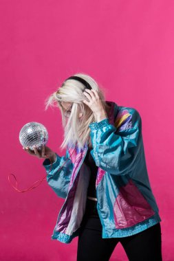 Young woman posing with a disco ball