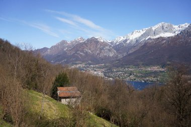Mountain landscape at winter near Asso, Como, Lombardy, Italy, and view of the Como lake