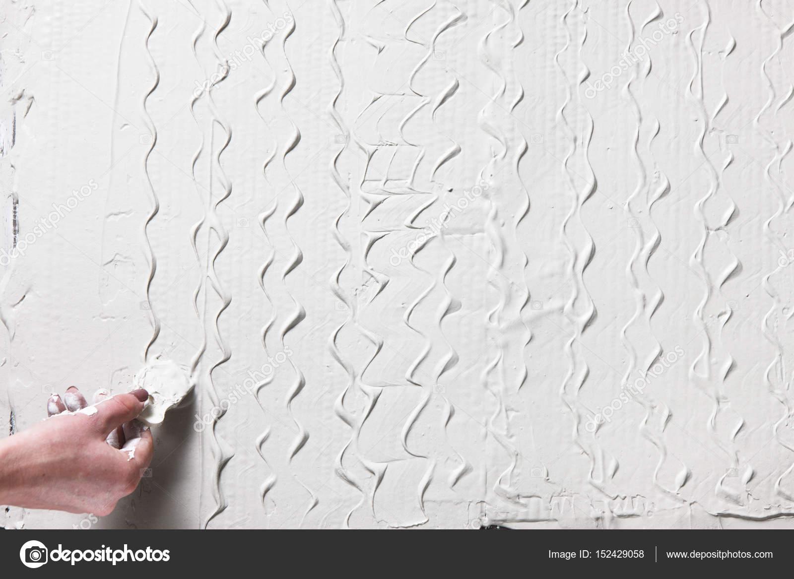 plâtre décoratif. que le motif soit main avec spatule — photographie