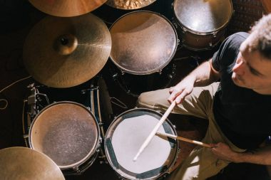 Drummer playing on drum set top view