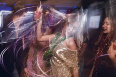 Active female in night club in blurred motion