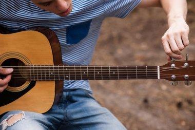 Musician lifestyle guitar nature concept.
