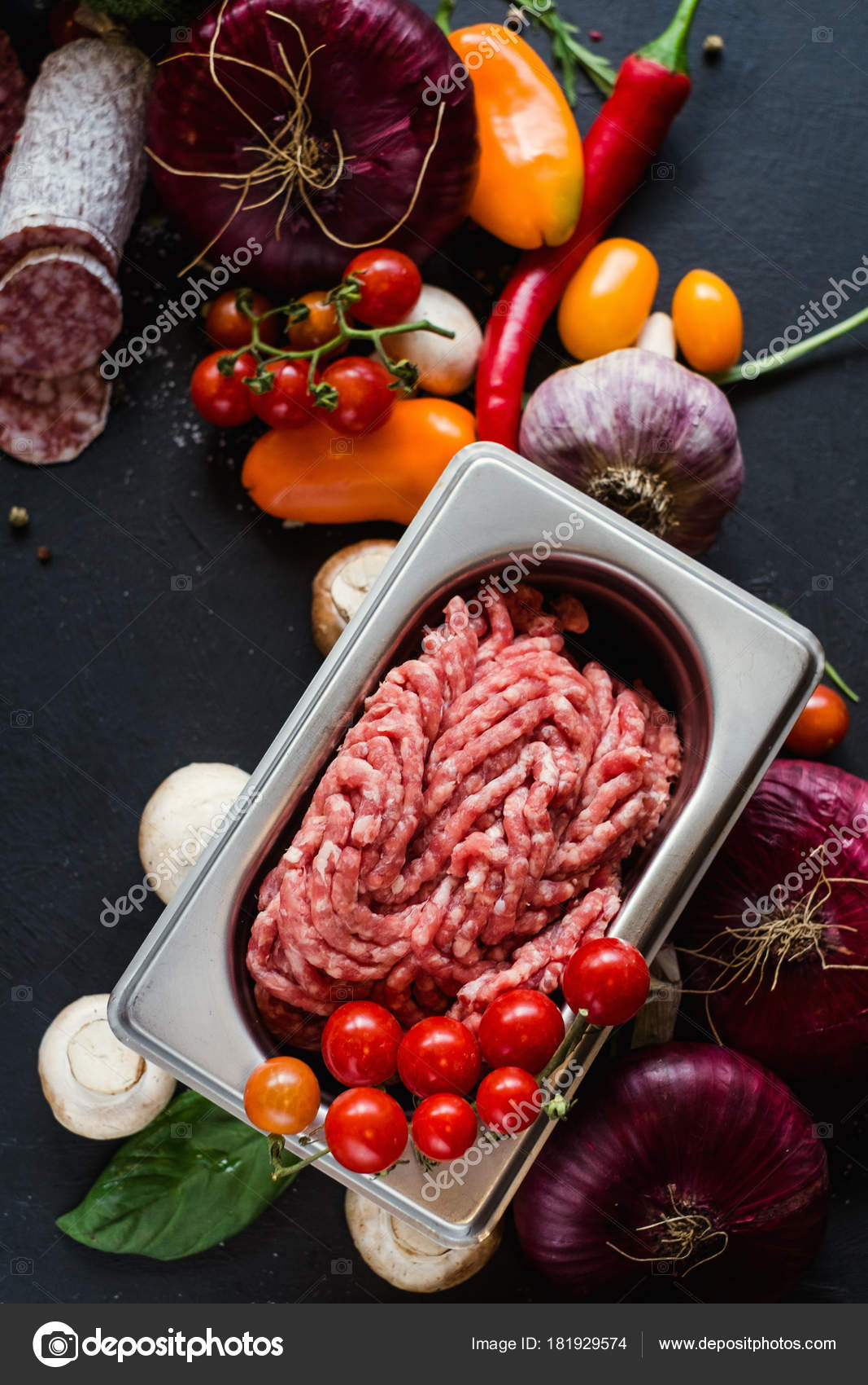 Assortment of homemade meat products. Italian salami recipe. Cooking with fresh ingredients concept — Photo by ...