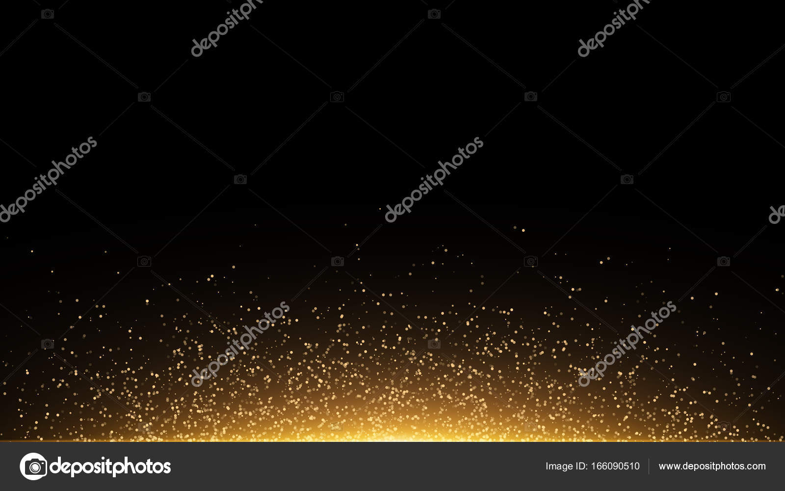 Golden glowing dust on a black background. Backlight from the bottom ...