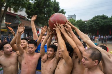 Hanoi, Vietnam - Feb 2, 2017: : Vietnamese men playing a game at the traditional ball scrambling festival in Thuy Linh village, Linh Nam ward, Hoang Mai district, Hanoi