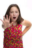 Young girl saying STOP!