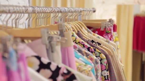 Motion shooting on rack with hangers and clothes in store.