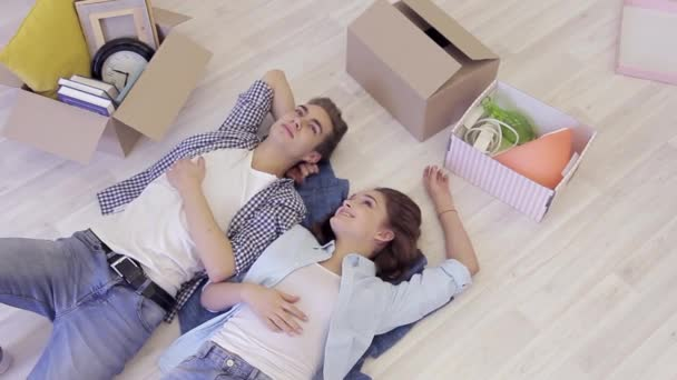 Couple lies on floor, communicate, dream of repairing new house
