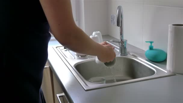 Video of washing dishes by a woman in 4K