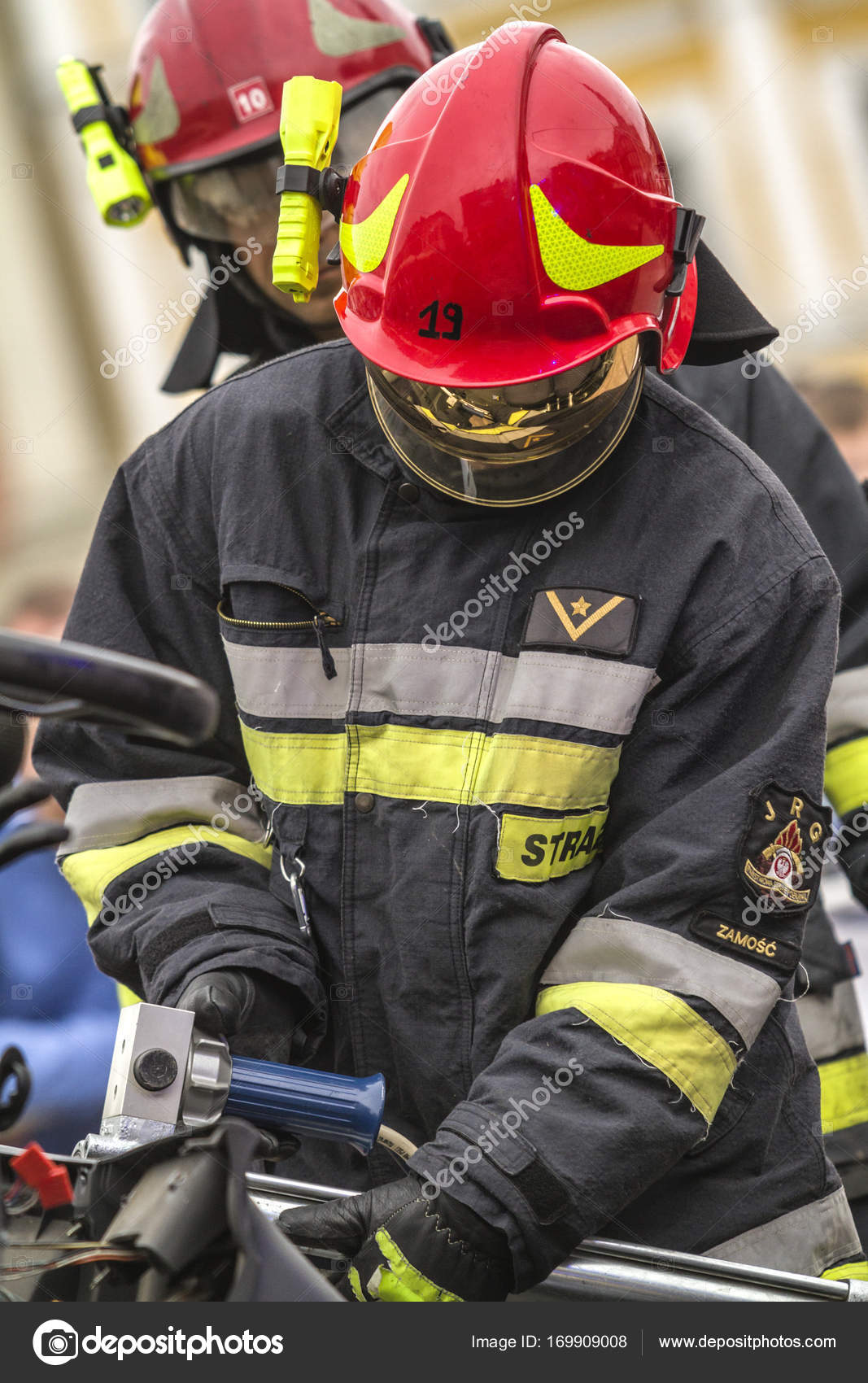 Firefighters working on an auto vehicle extrication – Stock