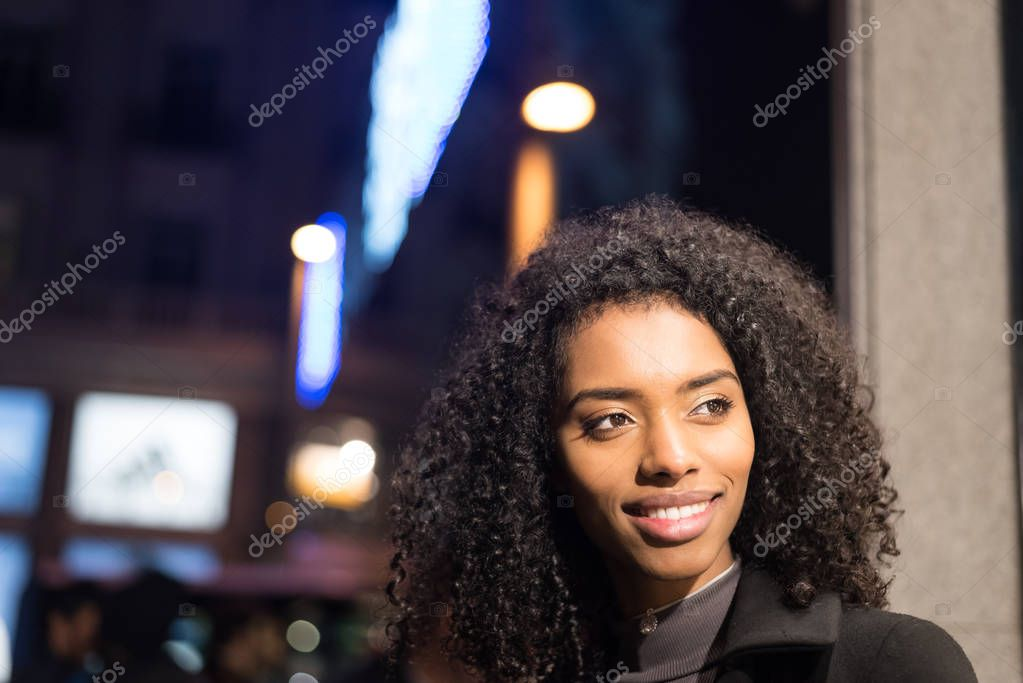 woman wondering in the city by night