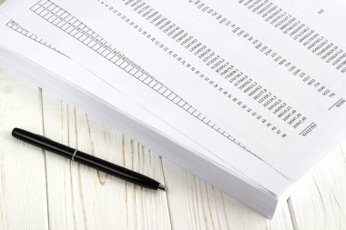 financial paper and pen on white wooden table