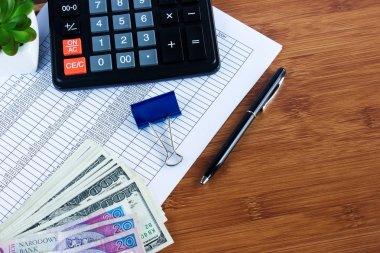 business concept: calculator,money, office accessoriesand financ