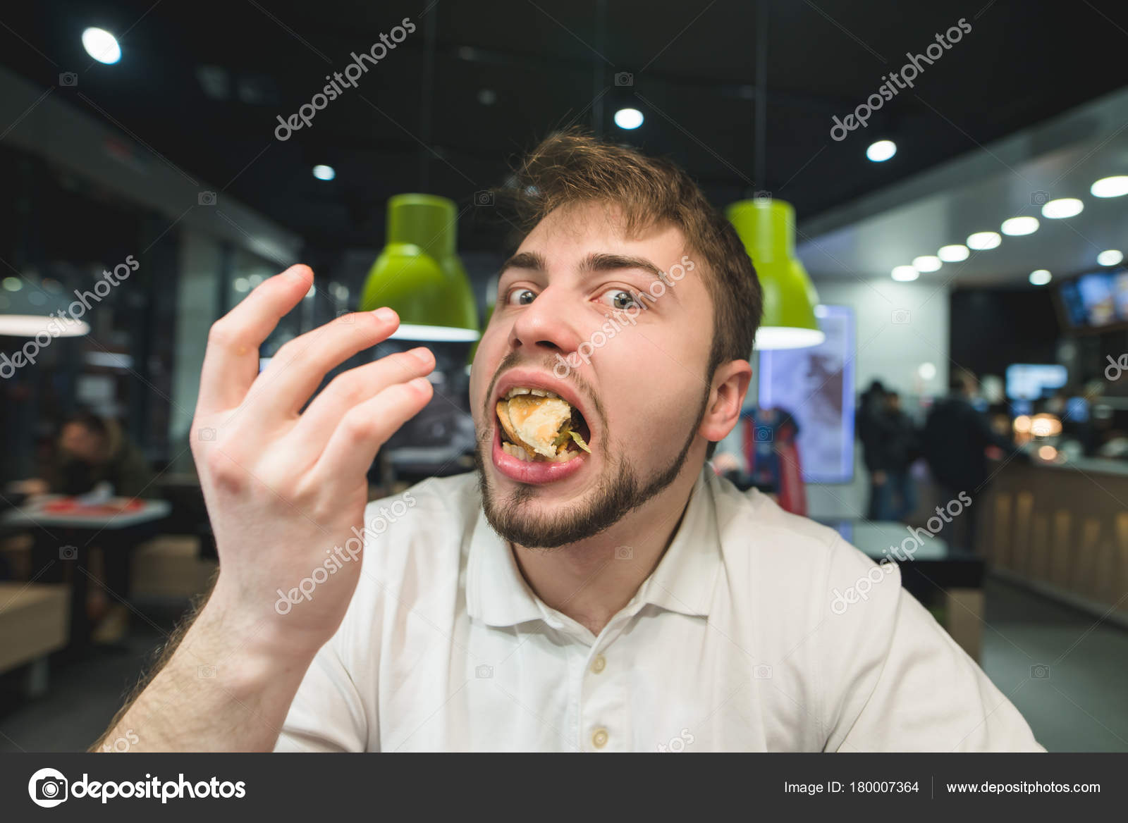 Free Young man with mouth full of food. Isolated of white ...