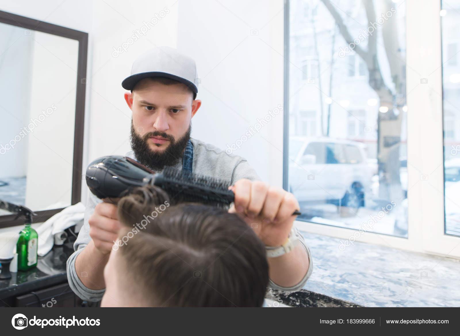 depositphotos_183999666-stock-photo-a-serious-barber-with-a.jpg