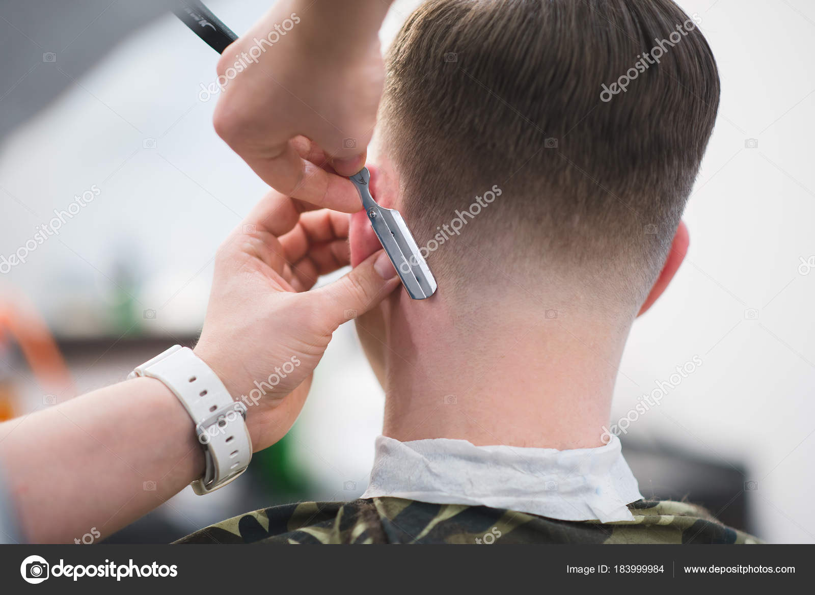 The Hairdresser Makes A Stylish Mens Hairstyle With A Dangerous