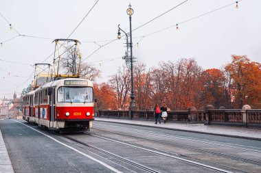 Red old tram on the street of Prague