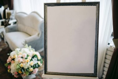 seating plan for guest at wedding in a silver frame with flowers and numbers