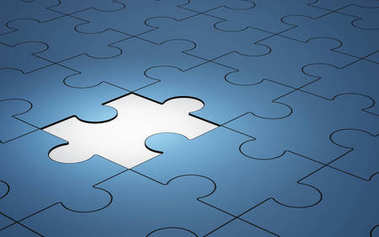 Blue jigsaw puzzle pieces with one piece glowing, 3d