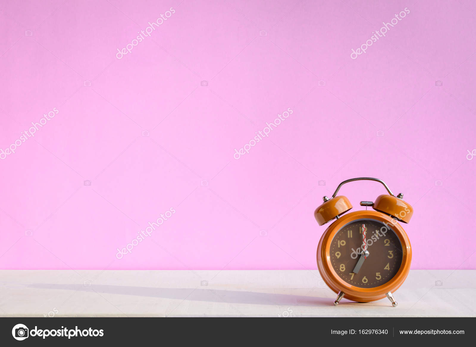 White Desk Clock With Pink Sweet Wall Stock Photo