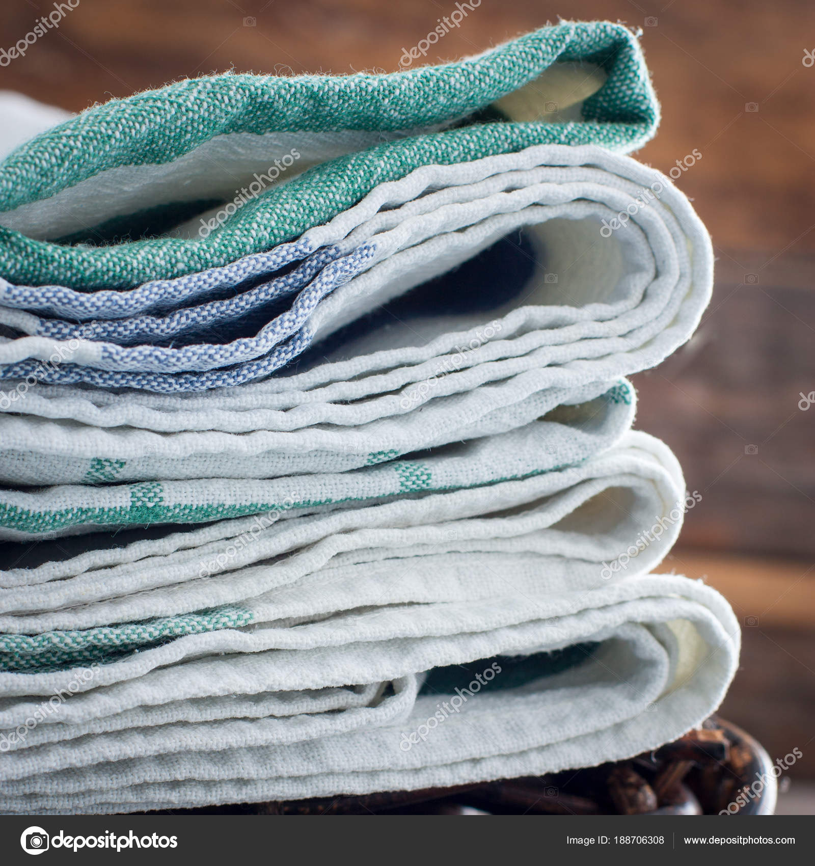 Clean kitchen towels stacked in a basket on the basket, selective ...