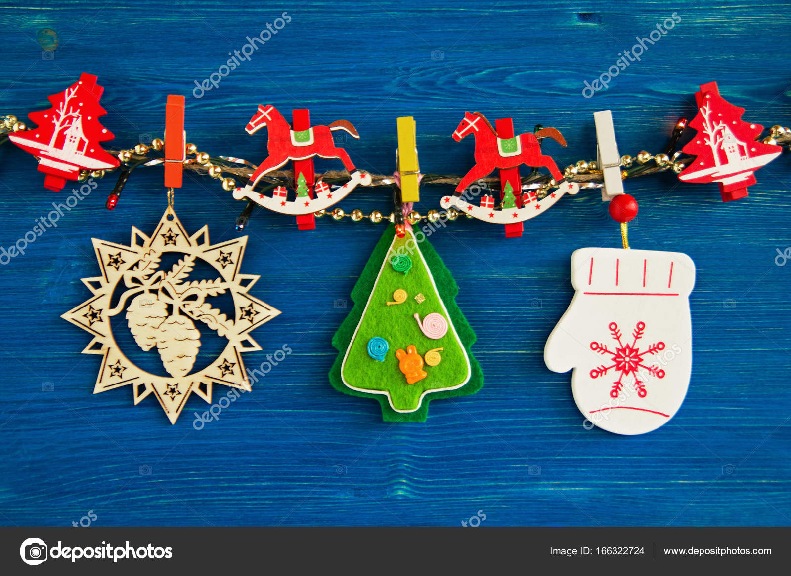 Wooden and felt colorful christmas decorations and christmas lights wooden and felt colorful christmas decorations and christmas lights on a rope on the blue wooden aloadofball Gallery