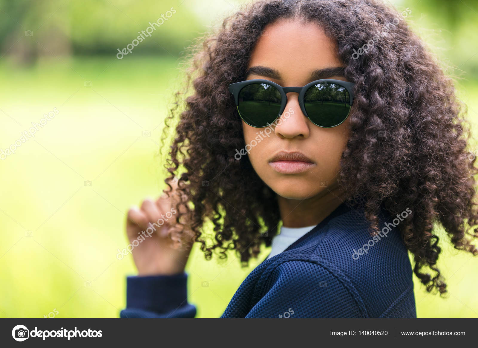 5ec8c1759f8 A beautiful sad moody mixed race African American female girl child teenager  young woman in sunshine wearing sunglasses with attitude — Photo by ...