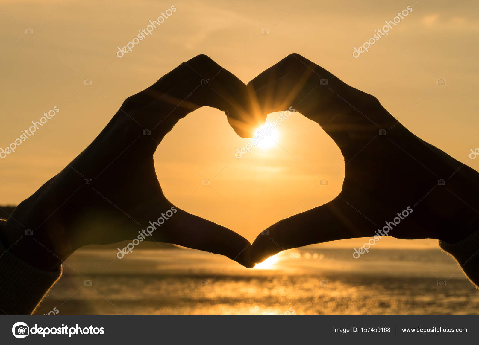 Hand Heart Frame Shape Silhouette Made Against The Sun Sky Of A Sunrise Or Sunset On Deserted Empty Beach Photo By Dmbaker