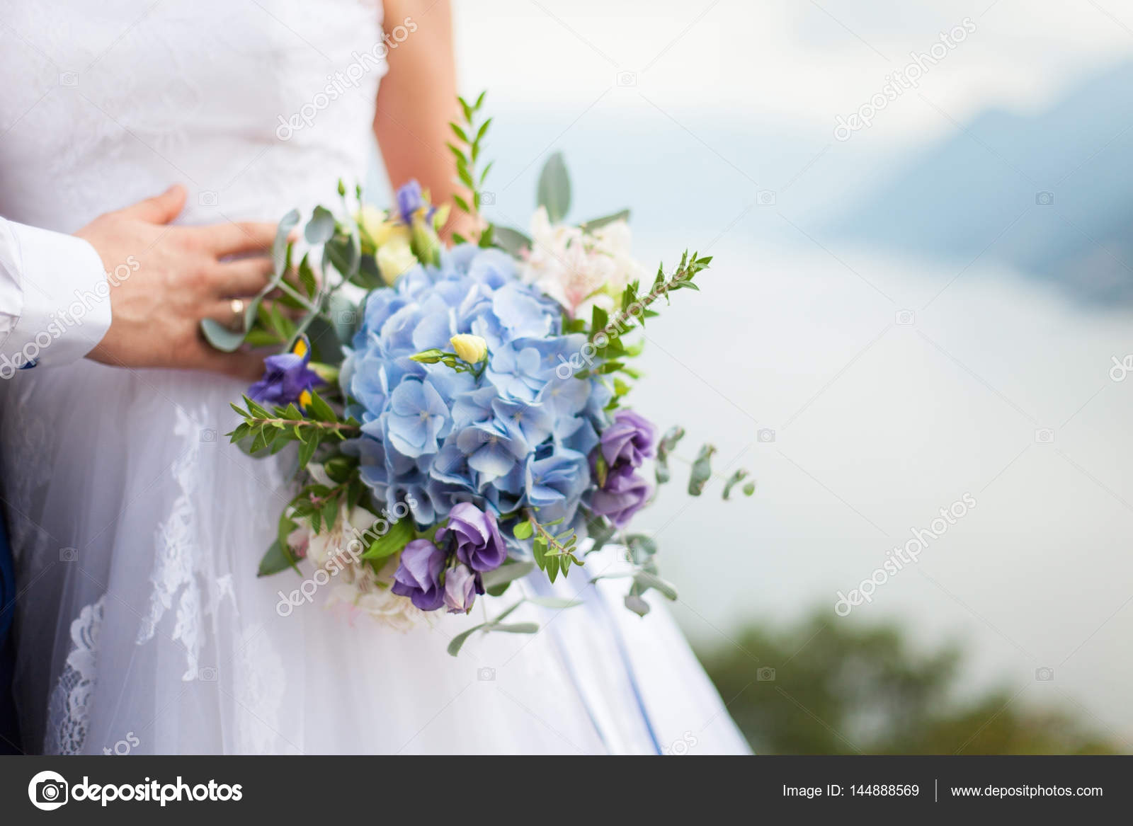 Bride Holds Wedding Bouquet From Blue Flowers Hydrangea And Stan