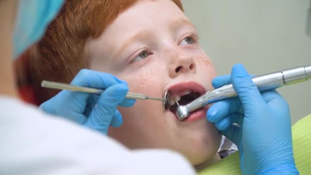 A little boy having a teeth cleaning treatment in the dentistry. Pediatric dentistry