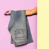 Photo Stylish clothes. Flared jeans. Denim. Minimal fashion. Wardrobe