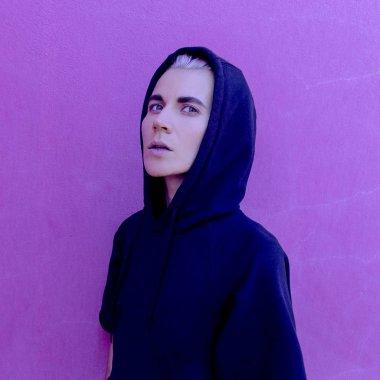 Girl and purple wall. Fashion minimal mood