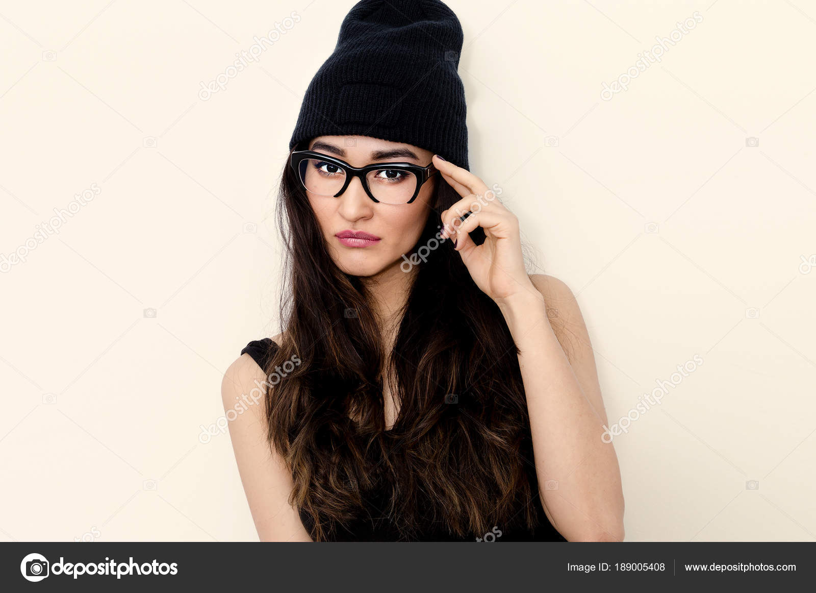 Swag Brunette Girl in stylish glasses and beanie cap — Stock Photo ... f975c87085c
