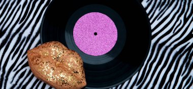 Vinyl and fashion lips on zebra print. Musical composition. Musi