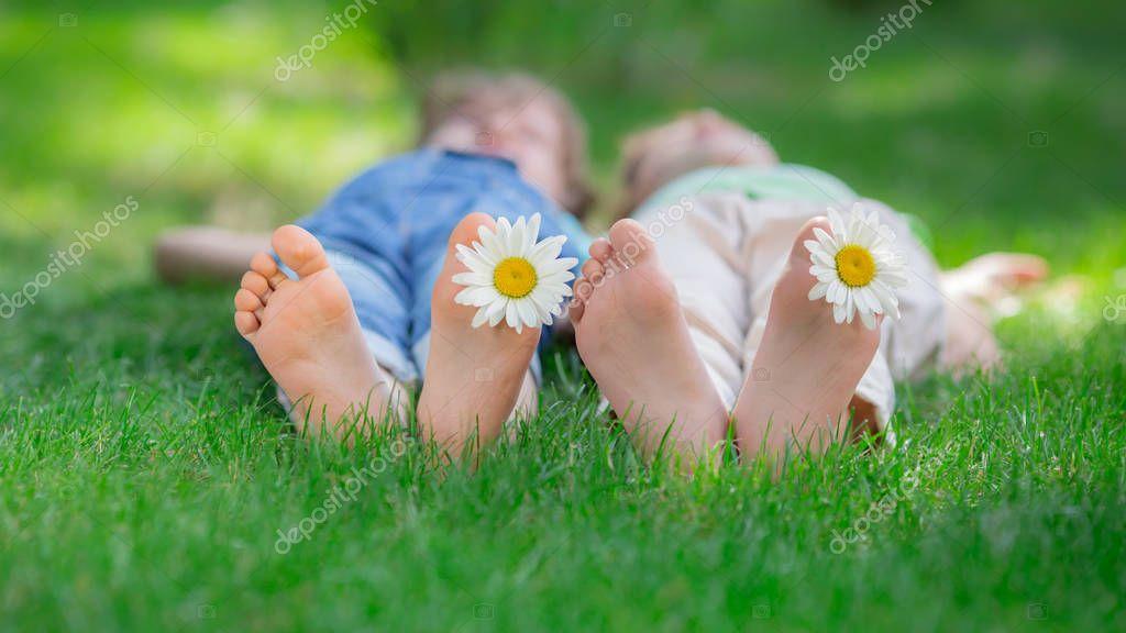 Friends lying on green grass