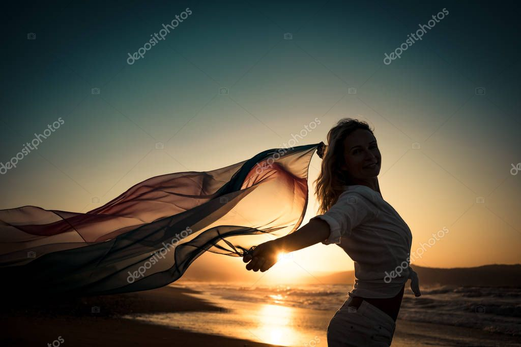 Silhouette of young woman at beach
