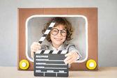 Fényképek Gyermek játszó rajzfilm Tv