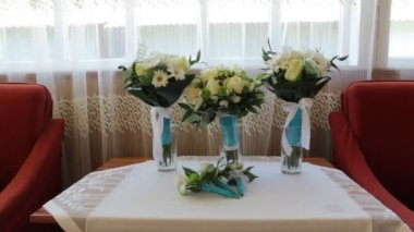 Three Wedding Bouquets and Boutonniere