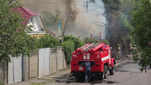 Práce hasičů v ohni