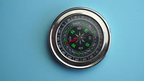 marine compass with movable arrow, reference point