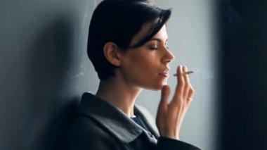 Fashionable woman smoking cigarette