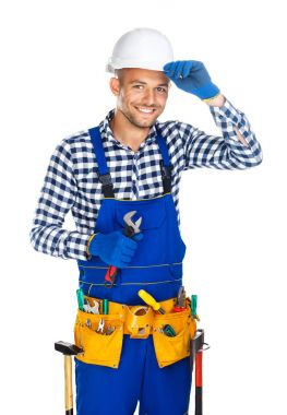 Friendly smiling construction worker with wrench