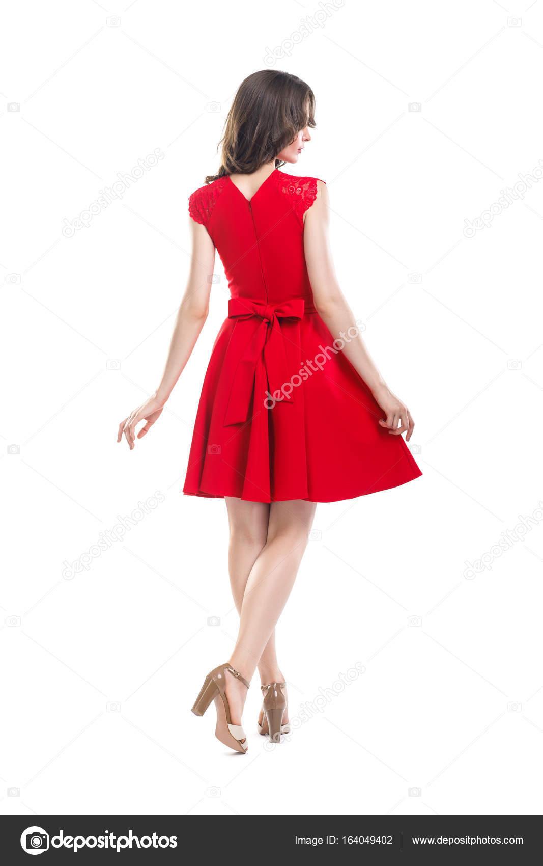 Rückansicht der junge schöne Frau im roten Kleid — Stockfoto ...
