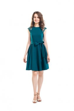Full length portrait of young beautiful woman in green dress